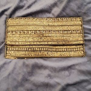 Super cute black and gold clutch
